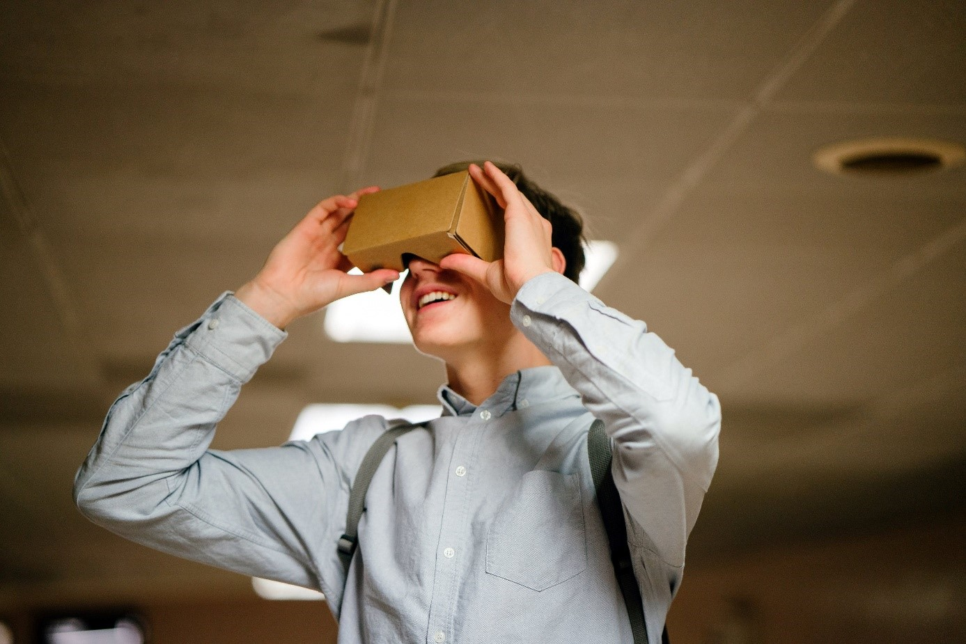 Man using Google Cardboard VR headset